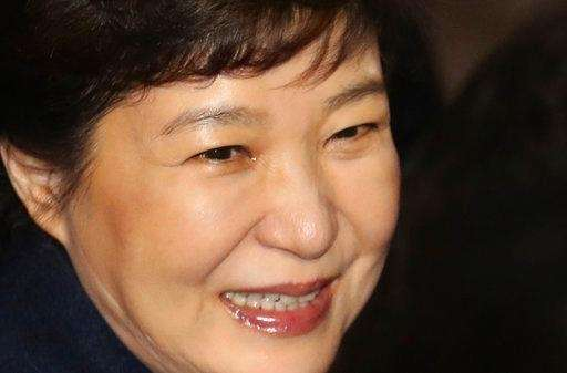 Ousted South Korean President Park Geun-hye smiles with