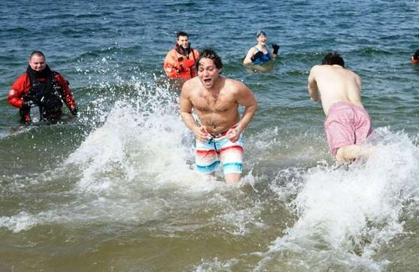 Participants brave the chilly water during the Cerebral