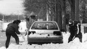 On March 12, 1993:Several people help dig out