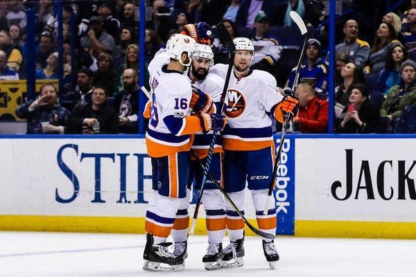 New York Islanders' Nick Leddy, center, is congratulated