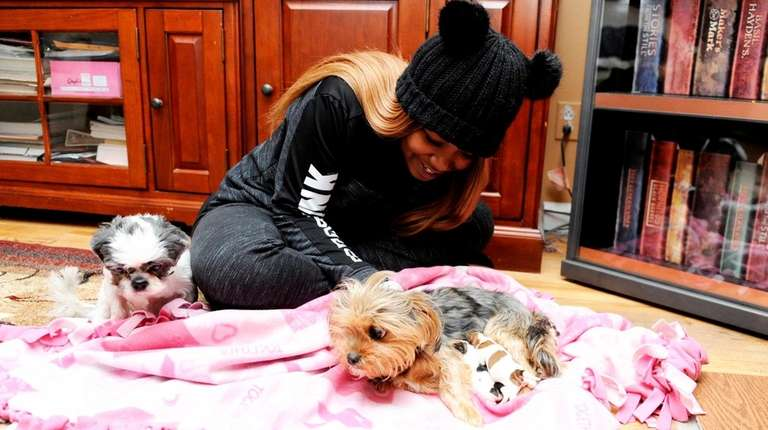 Dominique Baptiste, 24, comforts Zoey, and her four