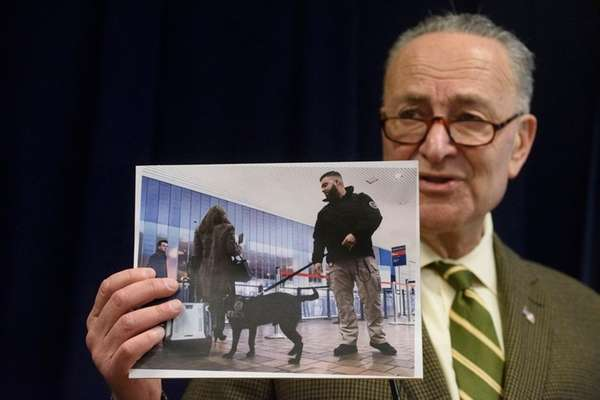 Sen. Chuck Schumer holds a photo of a