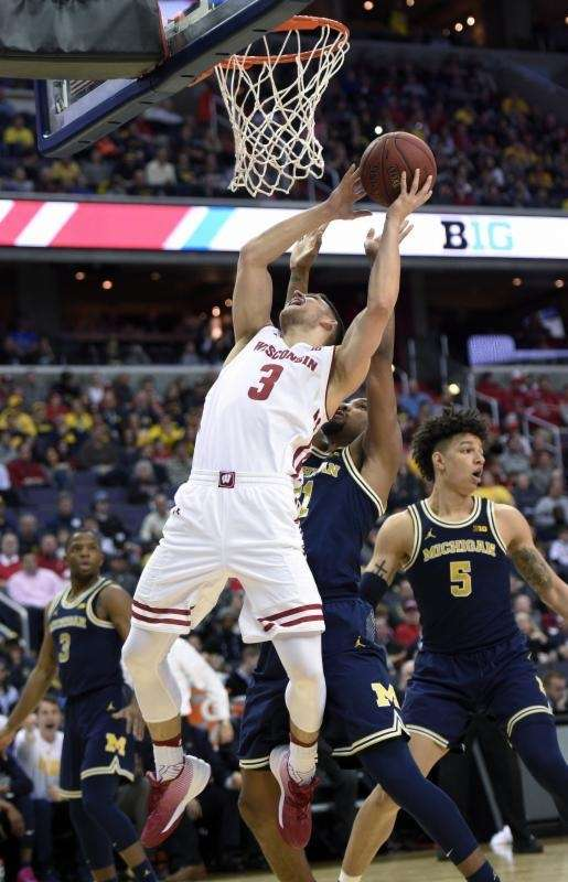 Wisconsin guard Zak Showalter (3) goes to the