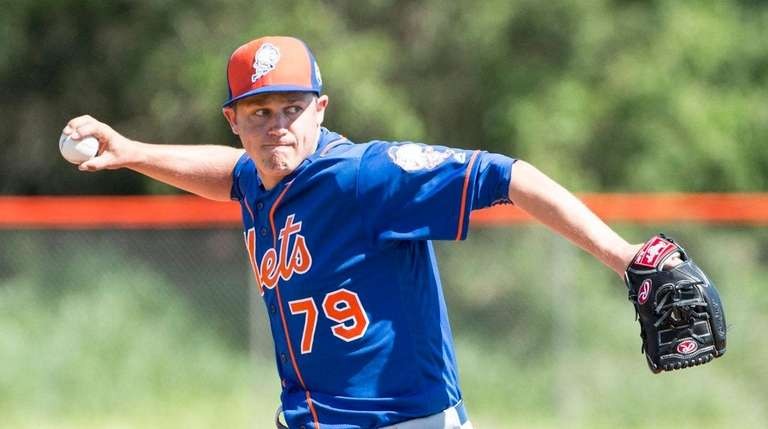 Mets pitcher Paul Sewald throws during a spring