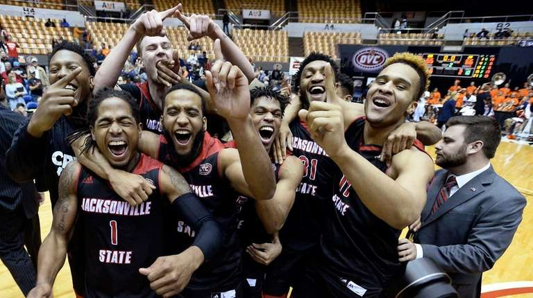 Jacksonville State players celebrate after defeating Tennessee-Martin in