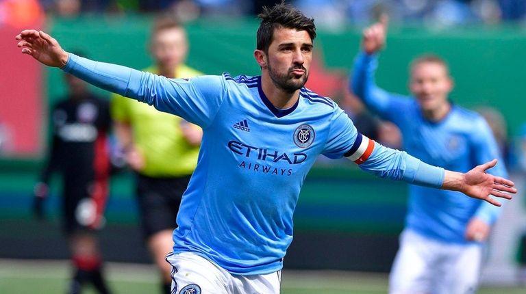 David Villa celebrates after scoring a first-half goal