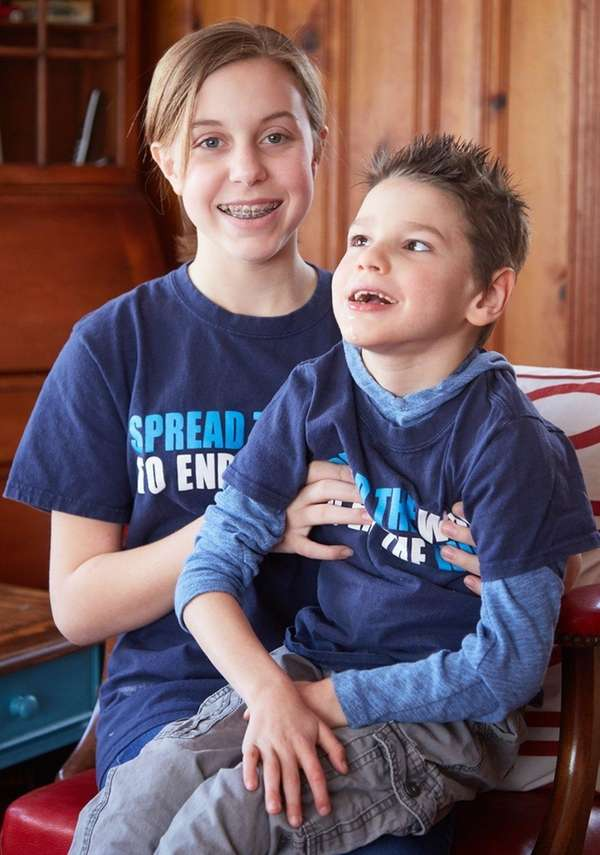 Emmariah Wyss, 13, with her brother Jackson, 8,