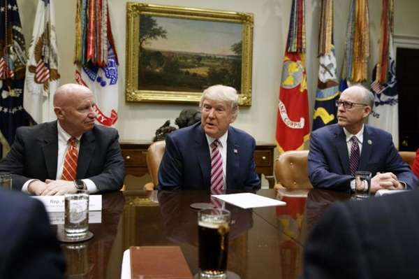 President Donald Trump, flanked by House Ways and