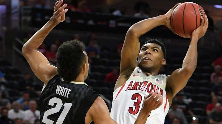 Allonzo Trier of Arizona goes to the