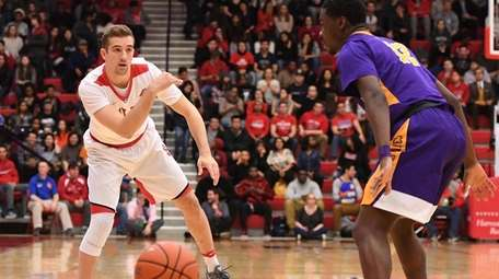 Stony Brook guard Lucas Woodhouse passes the ball
