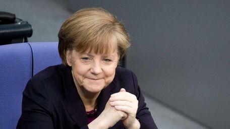 German Chancellor Angela Merkel smiles ahead of an