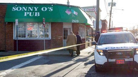 Nassau police investigate a crime scene on West