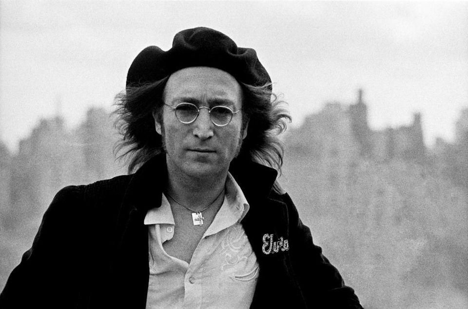 John Lennon's parents split when he was 3.