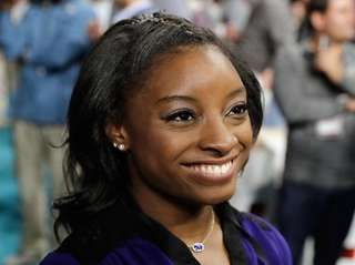 Simone Biles' maternal grandparents adopted her and her