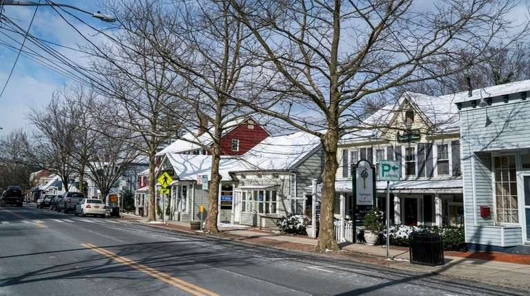 Main Street in Cold Spring Harbor features shops,