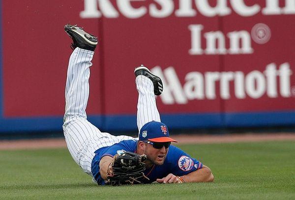 Mets leftfielder Tim Tebow makes a diving catch