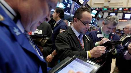 Traders Richard Newman, left, Robert Arciero, center, and