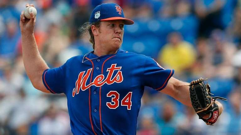 Mets starting pitcher Noah Syndergaard works the first inning