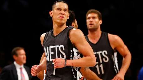 Jeremy Lin, front, of the Brooklyn Nets reacts against