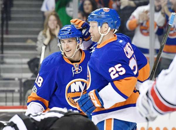 Ryan Strome, #18, is congratulated by his teammate