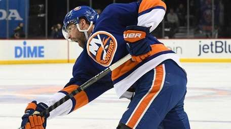 New York Islanders defenseman Johnny Boychuk shoots the