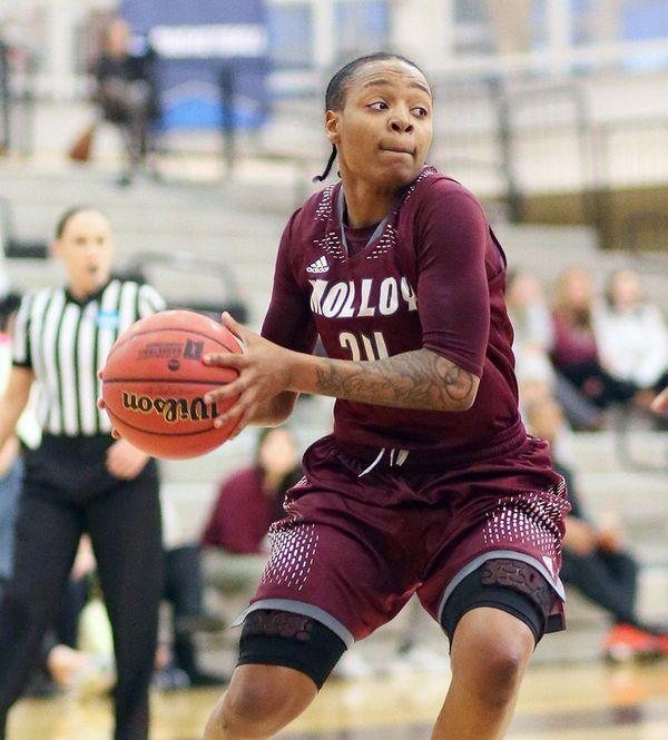 Molloy's Aliyah McDonald looks inside during an NCAA