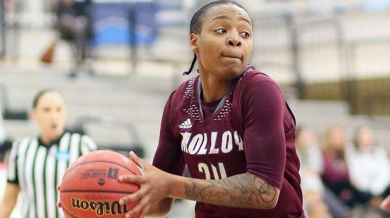 Molloy's Aliyah McDonald looks inside during an NCAA