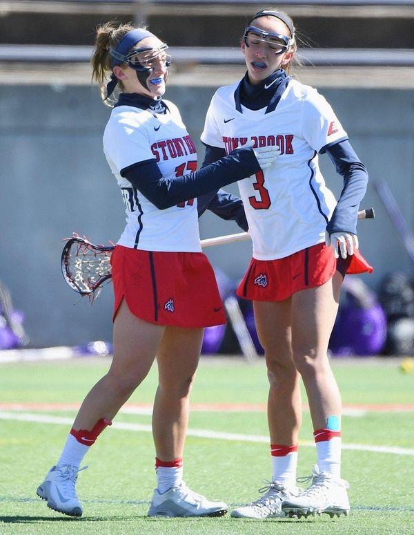 Stony Brook attacker Kylie Ohlmiller, left, celebrates her