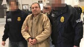 Federal agents escort alleged Mexican drug kingpin Joaquín