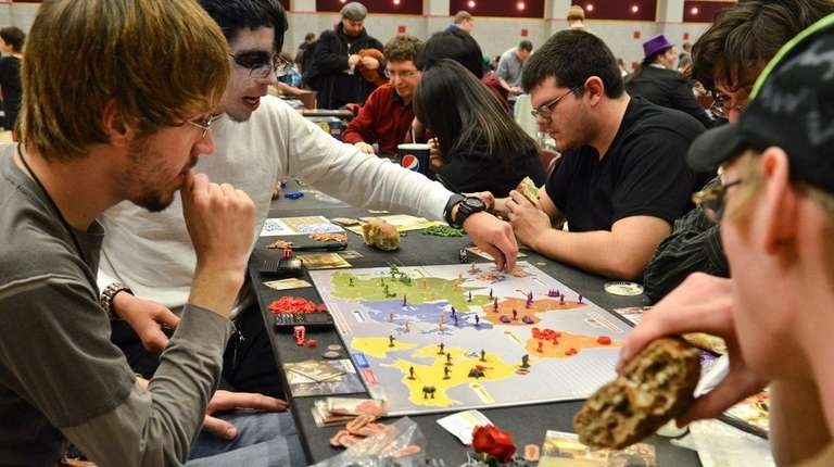 Friends play a board game called Risk Legacy