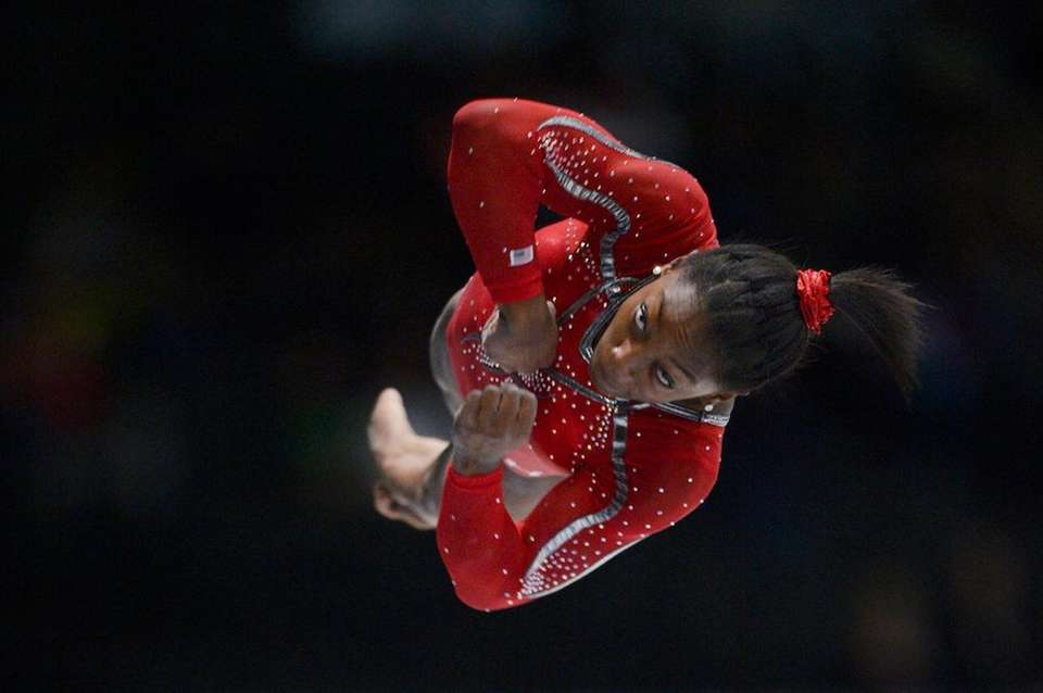 Gymnast Simone Biles competes in the vault qualifications
