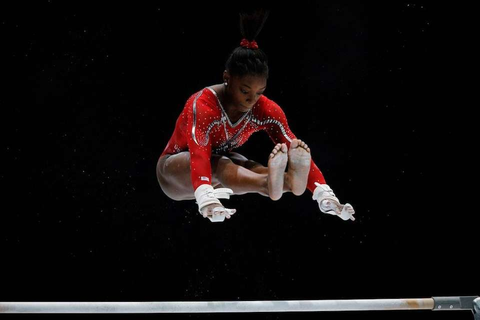 Simone Biles competes at the Artistic Gymnastics World