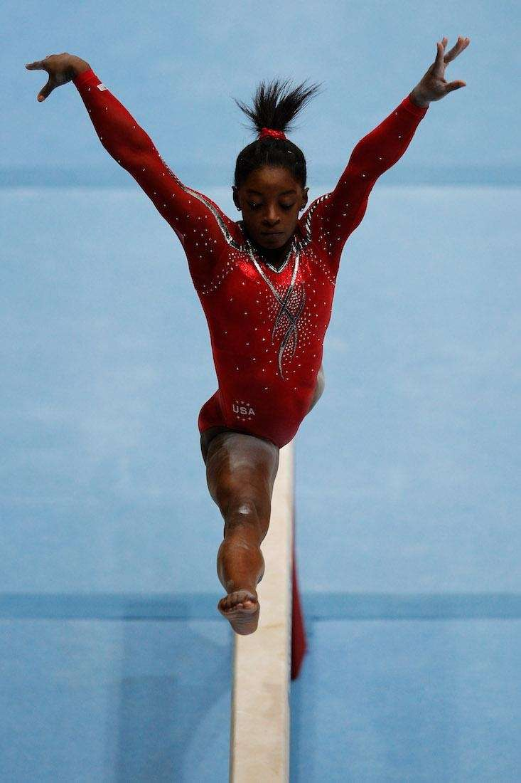 Simone Biles competes in the balance beam at