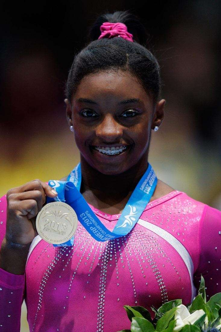 Simone Biles poses after winning the Women's All-Round