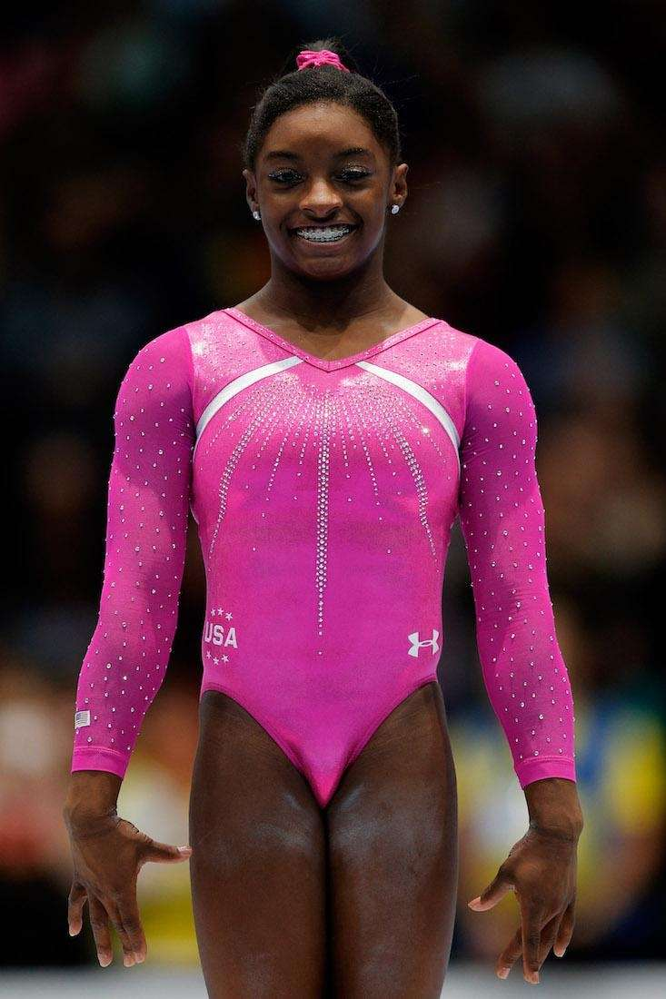 Simone Biles poses after winning the Womens All-Round