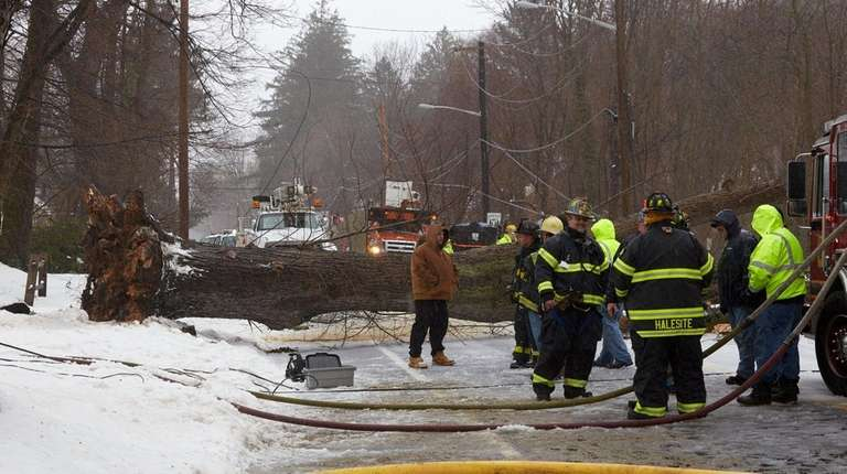 Firefighters and emergency personnel work at the scene