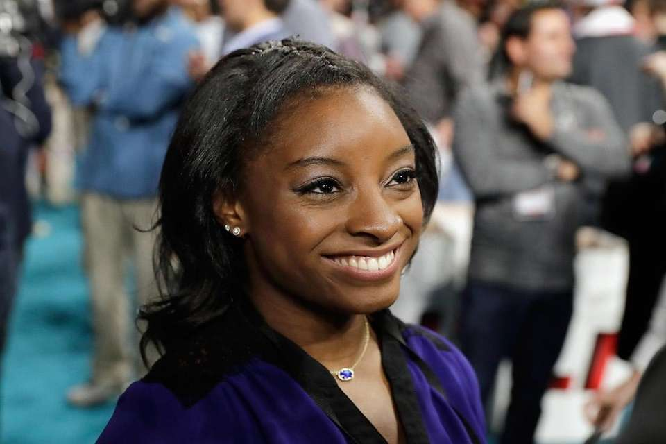 Olympic gold medalist Simone Biles is interviewed during