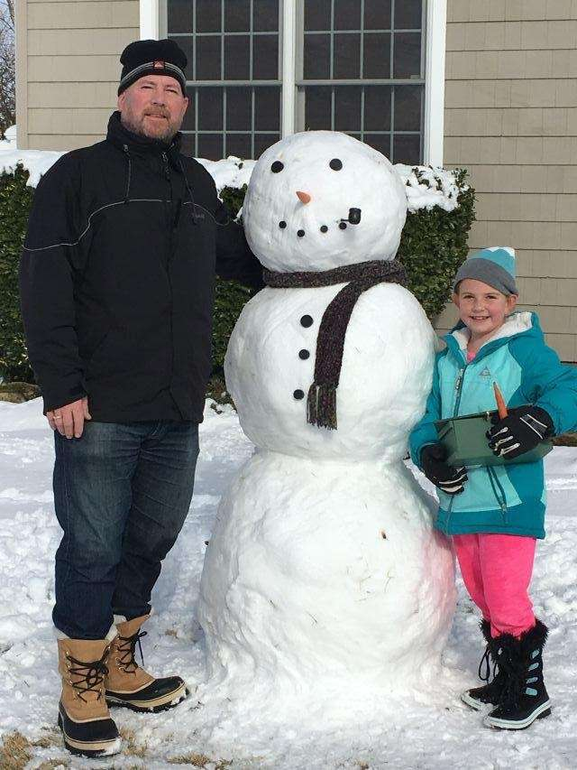 Pat and Lucy mulcahy making a snowman on