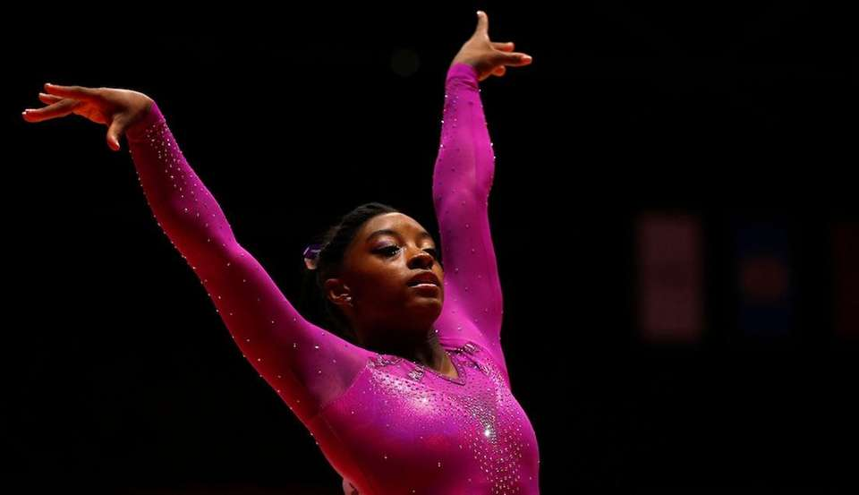 Simone Biles performs during her floor exercise at