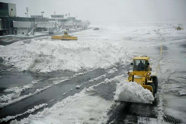 Plows clear a tarmac at LaGuardia Airport in