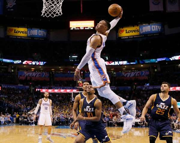 Oklahoma City Thunder guard Russell Westbrook, center, goes