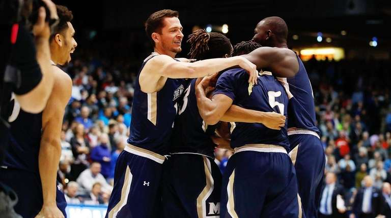 The Mount St. Mary's Mountaineers celebrate defeating the