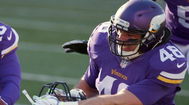 Minnesota Vikings fullback Zach Linepulls Seattle Seahawks wide