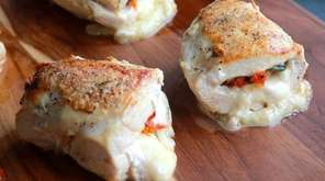 Chicken breasts are split and stuffed with part