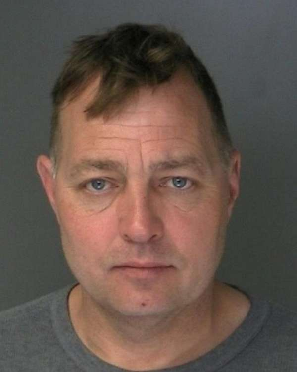 Edward Motl, 50, of Mastic, was arrested Tuesday,