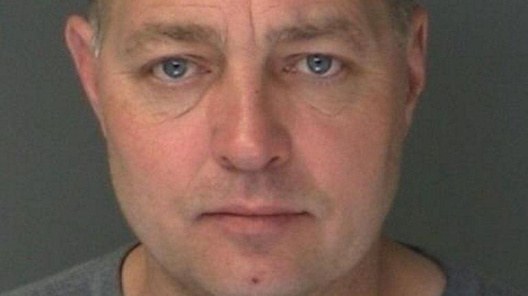 Edward Motl, 50, of Mastic, was arrested Tuesday,