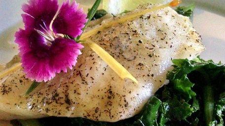 Lemon pepper-crusted sole over sautéed garlic kale is