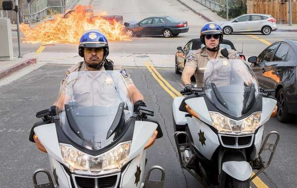 Michael Peña, left, and Dax Shepard ride to
