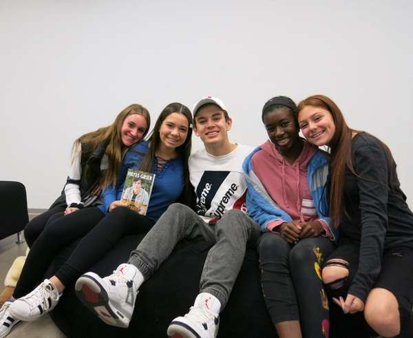 Hayes Grier, center, with Kidsday reporters, from left,