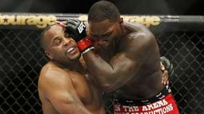 Daniel Cormier, left, and Anthony Johnson duel in